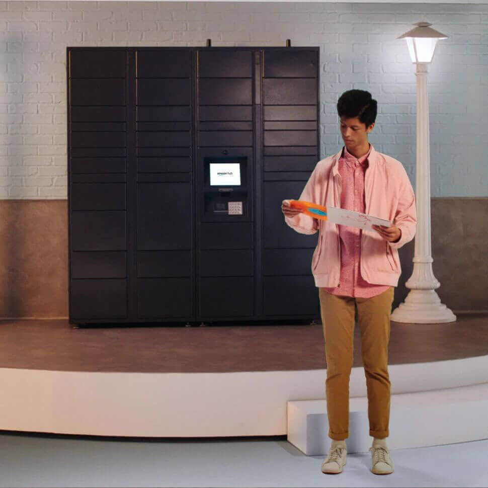 Man standing by Amazon Lockers and reviewing a guide on how to use Amazon Lockers